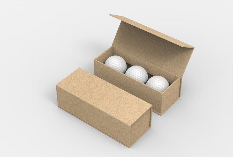 golf balls are placed in boxes after completion